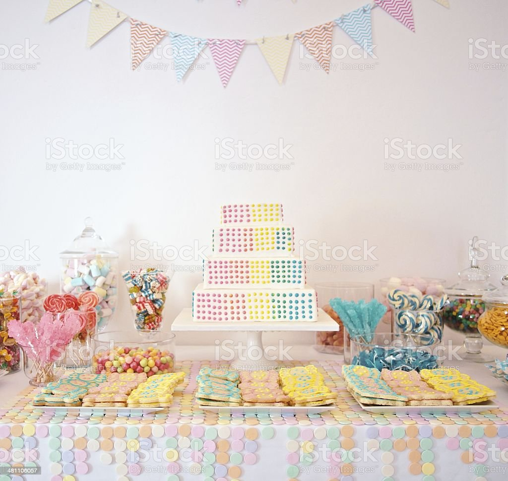 Baby party table setting with cake and candies stock photo