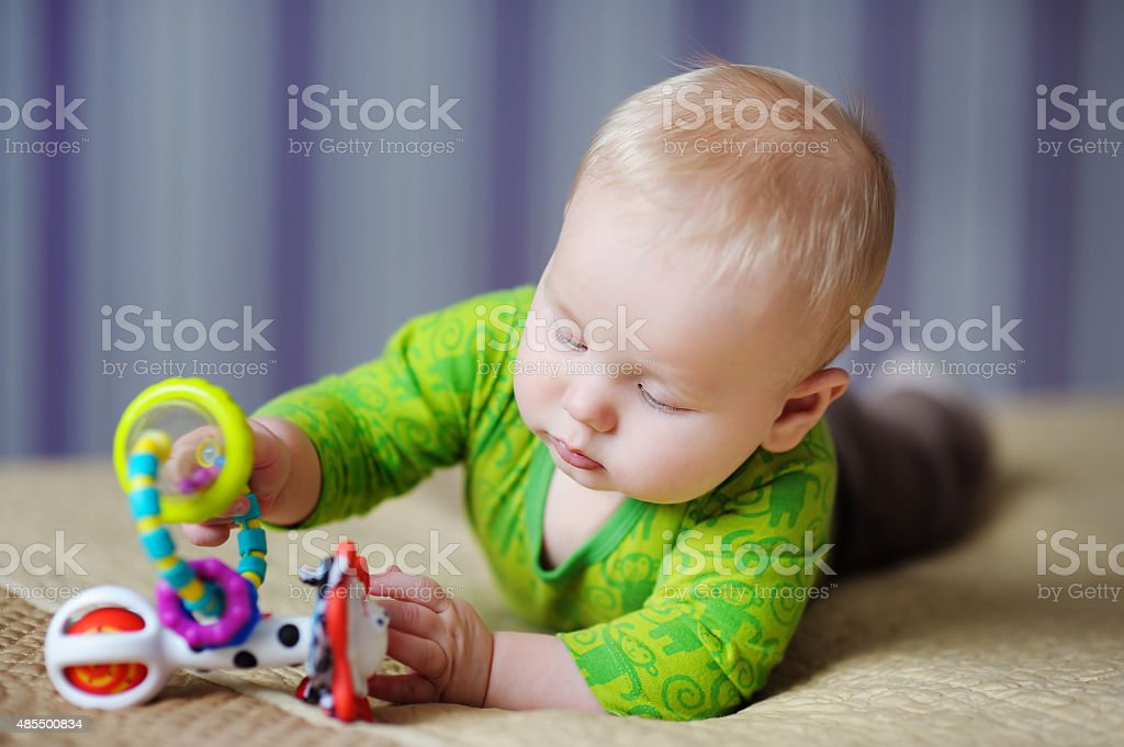 Baby play with bright toys stock photo