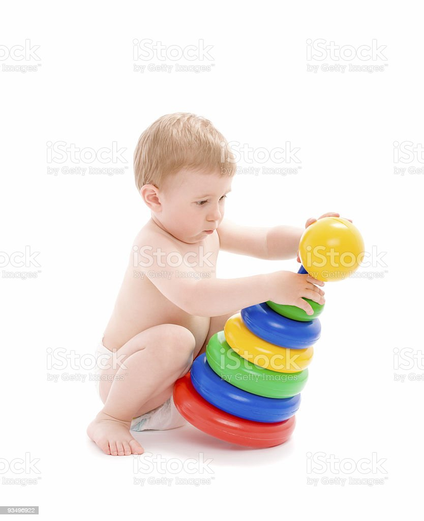 Baby play with tower from colorful discs stock photo