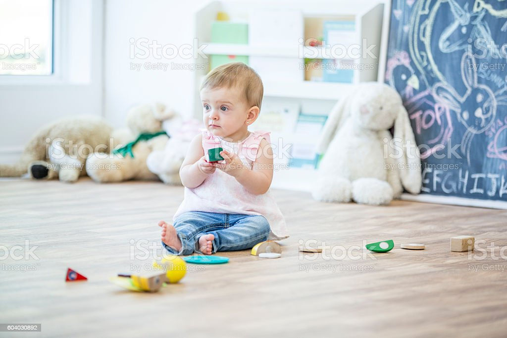 Baby Playing Alone stock photo