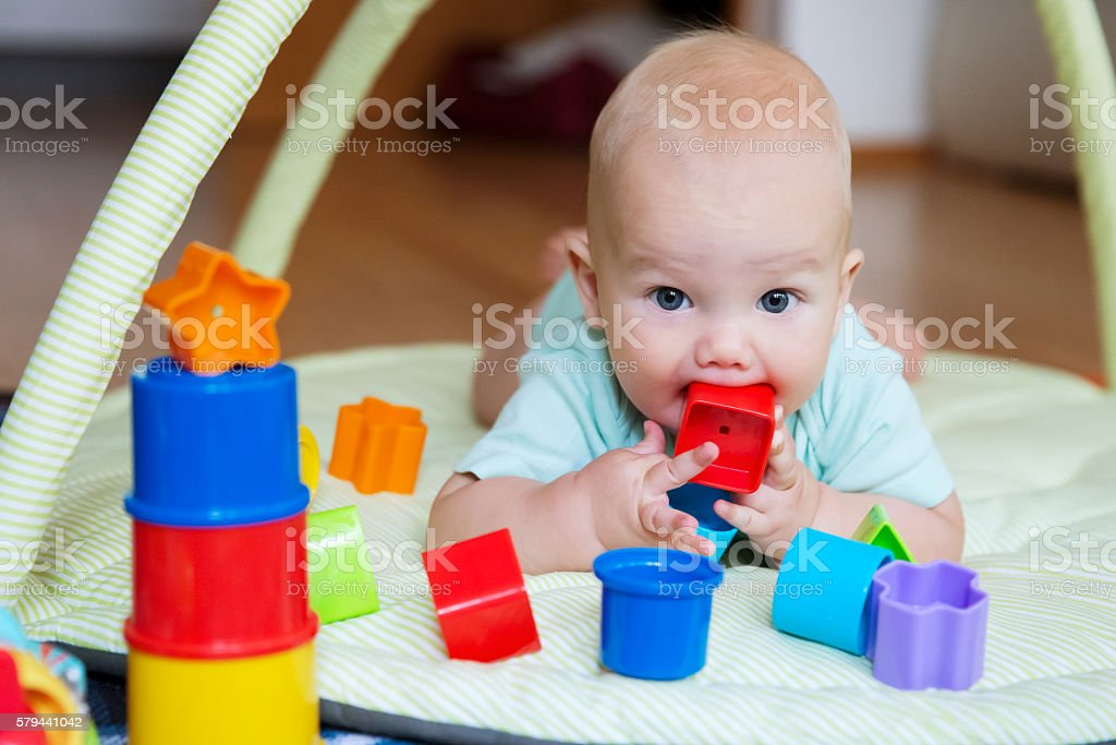 Baby playing and discovery stock photo