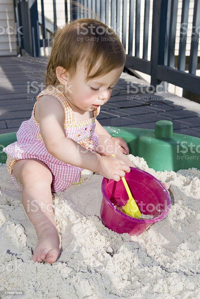 Baby Playing in Sandbox stock photo