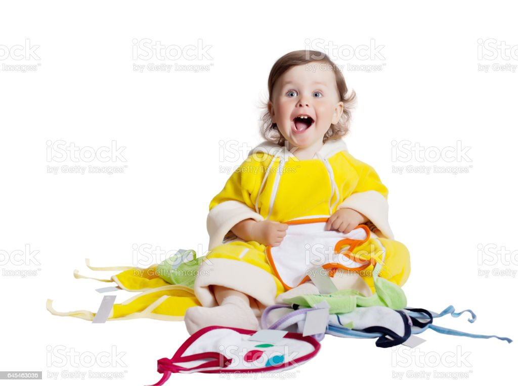 Baby playing in studio on white background stock photo