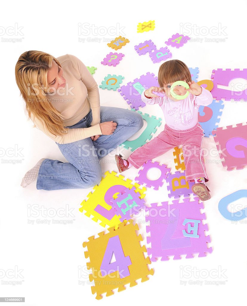 Baby playing on a puzzle royalty-free stock photo