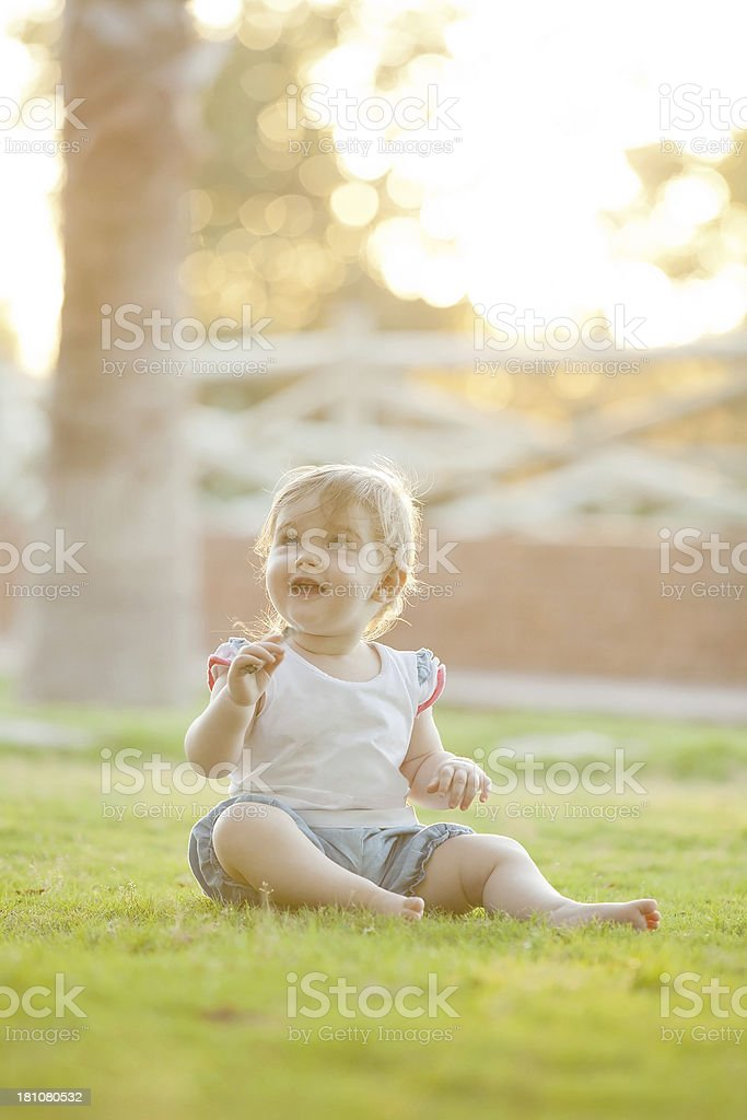 Baby playing on the field royalty-free stock photo