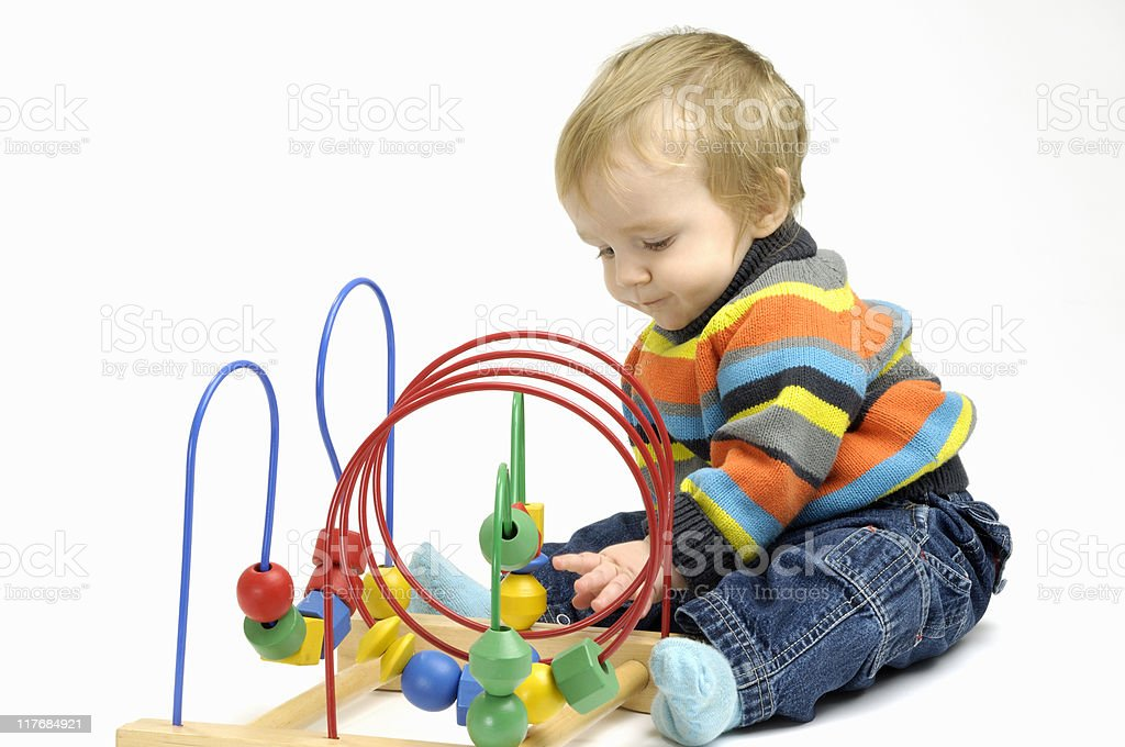 Baby playing with a toy stock photo