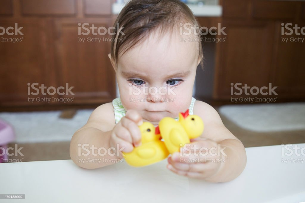 Baby Playing With Duckies stock photo