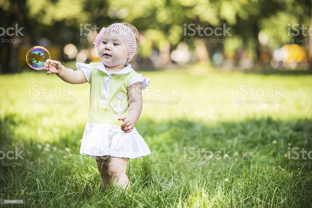 Baby playing with soap bubbles royalty-free stock photo