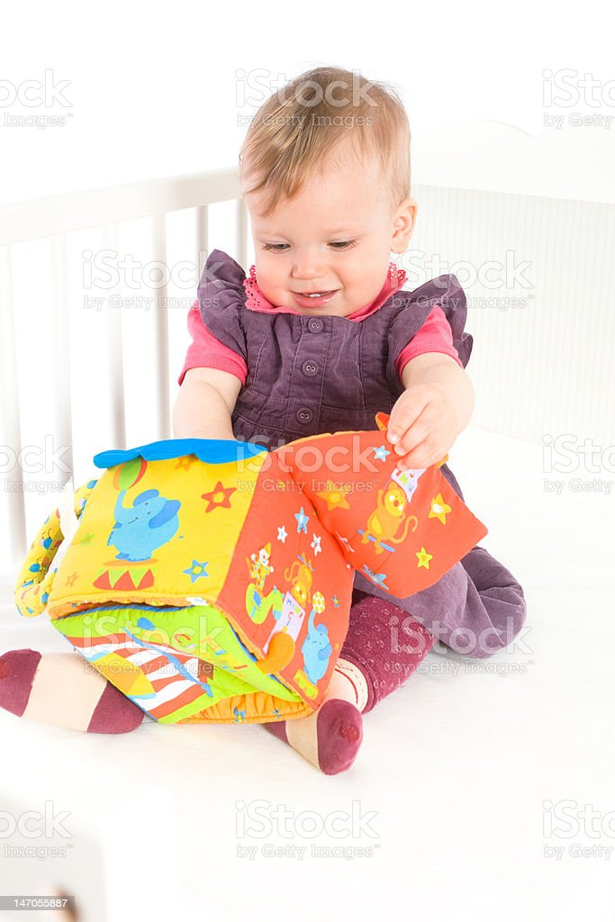 Baby playing with soft toy stock photo