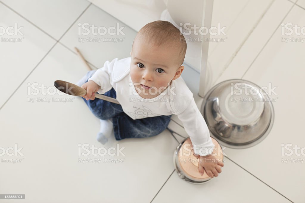 Baby playing with spoon and bowls royalty-free stock photo