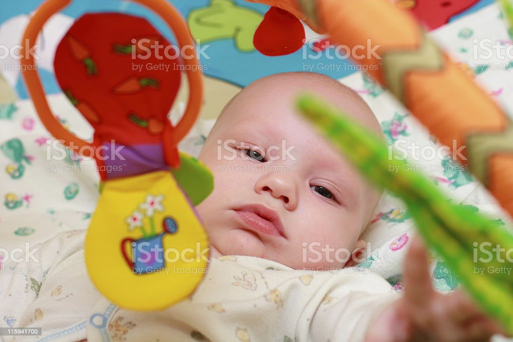 Baby playing with toys royalty-free stock photo