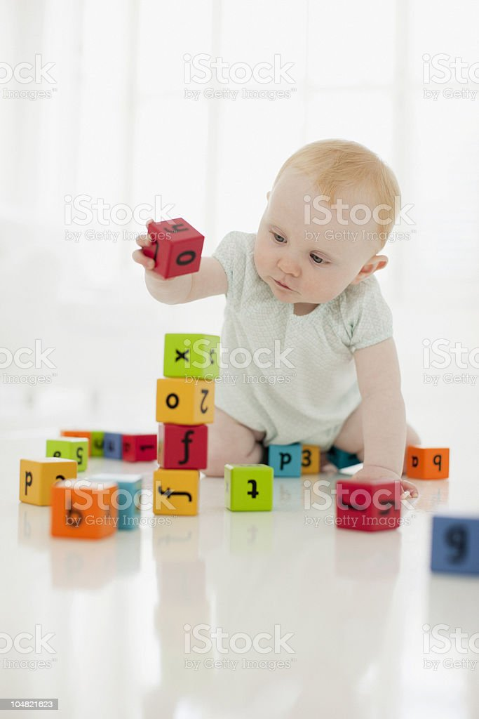 Baby playing with wood blocks royalty-free stock photo