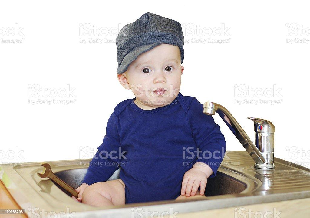 baby plumber repairs water tap stock photo