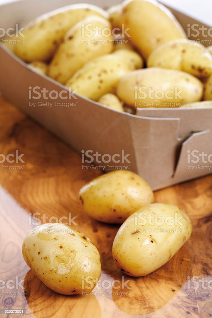 Baby potatoes in cardboard, close-up stock photo