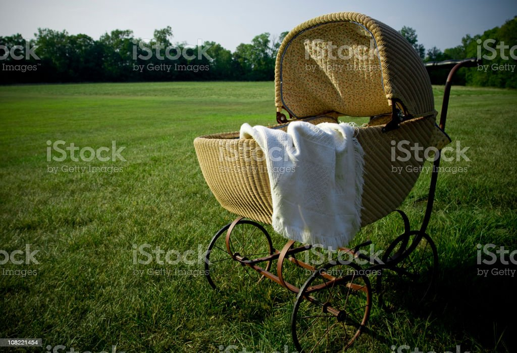 Baby Pram in a Field royalty-free stock photo