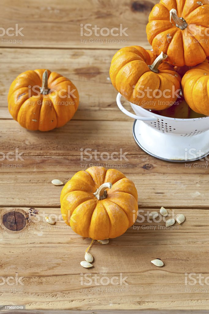 Baby Pumpkins on wooden surface. royalty-free stock photo