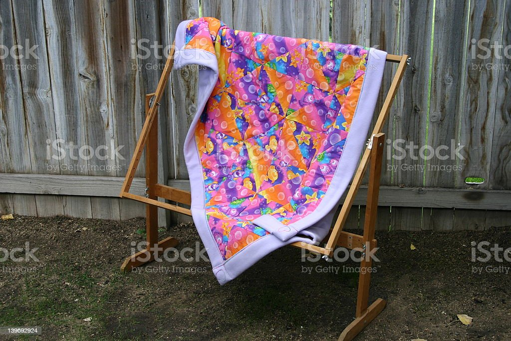 baby quilt on quilt stand royalty-free stock photo