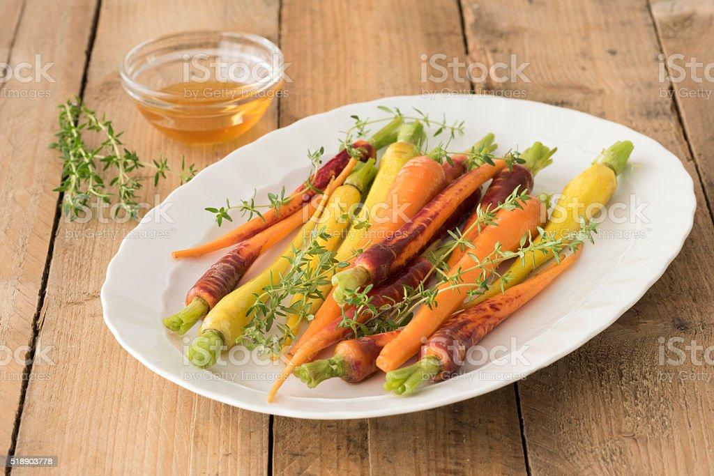 Baby Rainbow carrots stock photo
