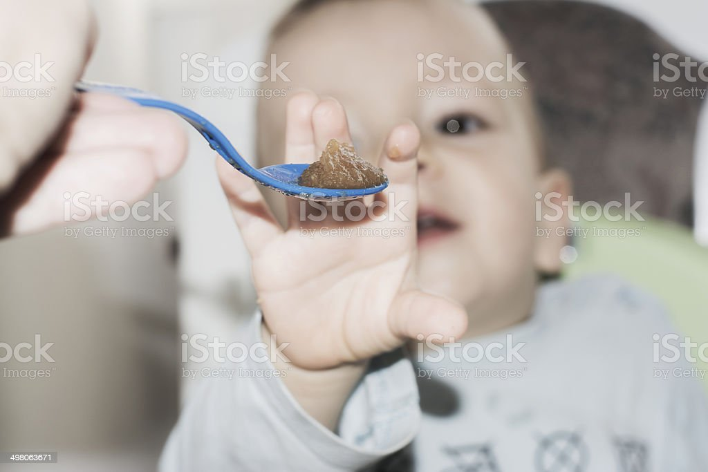 Baby refuses baby food close up of a spoon stock photo