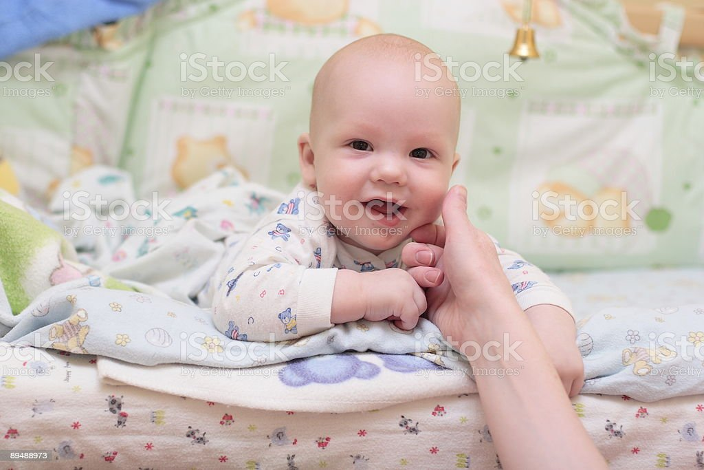 Baby rest on bed and look at camera #3 royalty-free stock photo