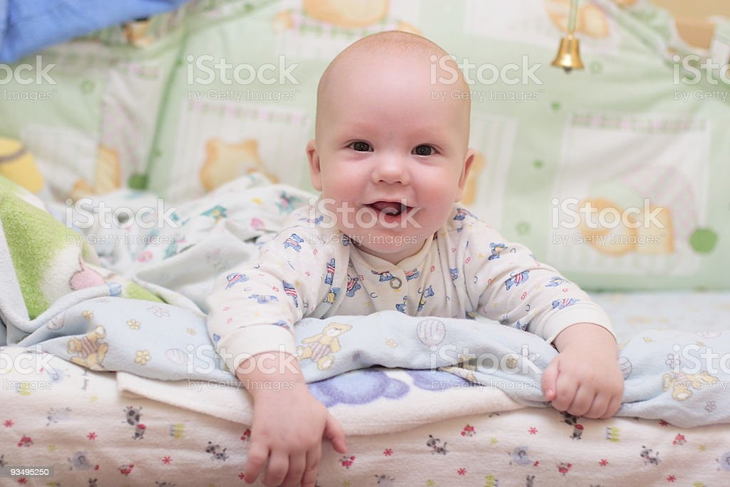 Baby rest on bed and look at camera #2 stock photo