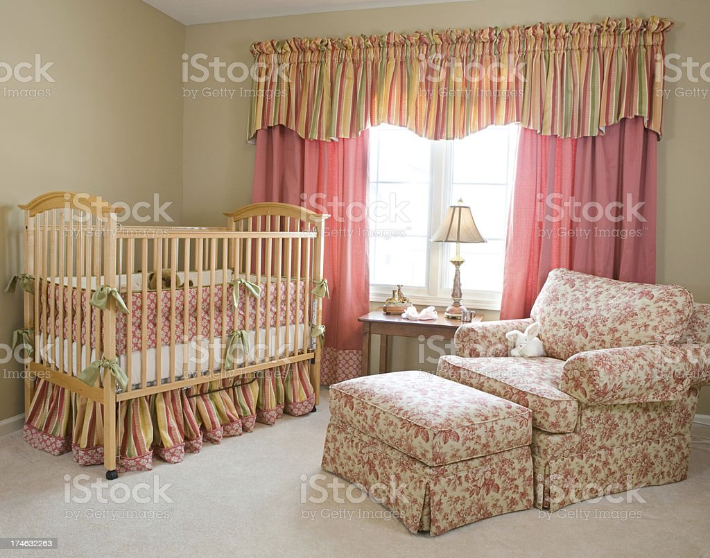 baby room with crib and chair royalty-free stock photo