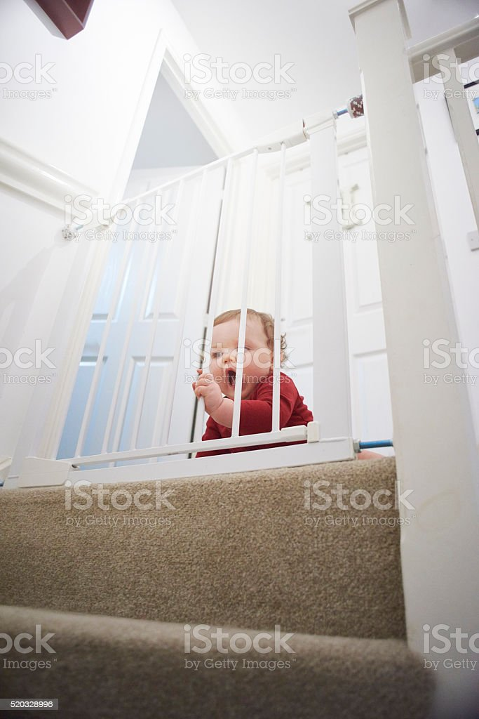 Baby safety gate on stairs stock photo