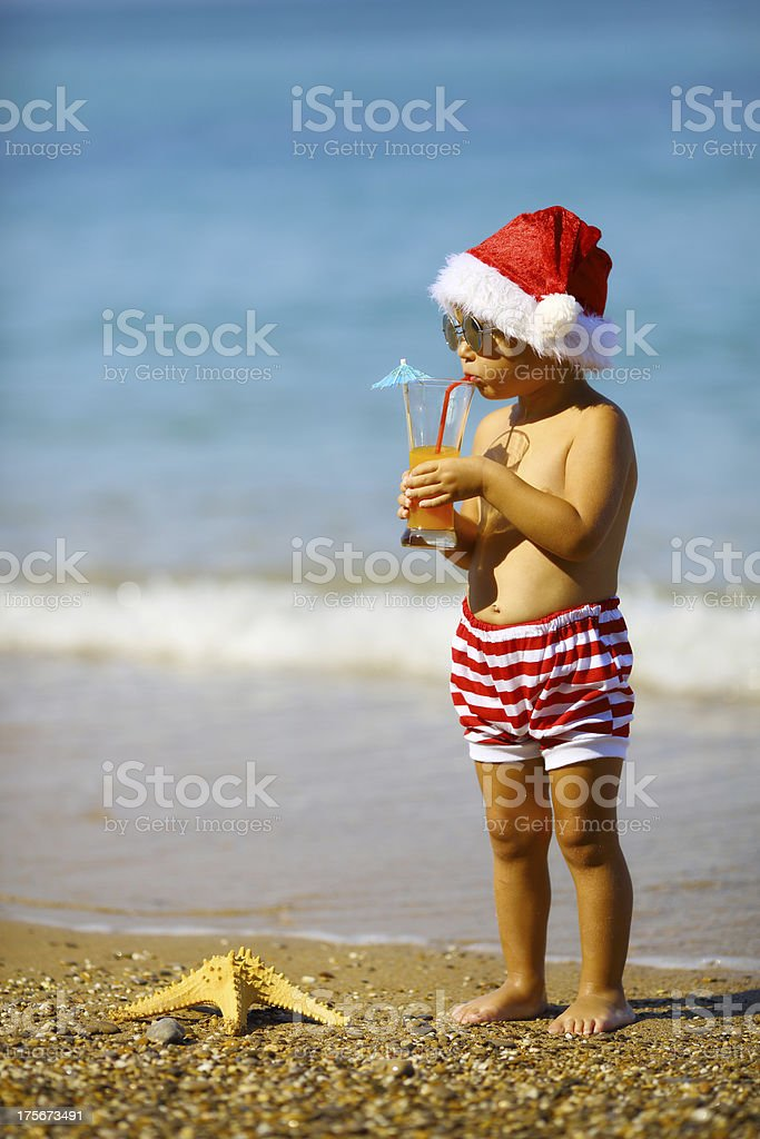 Baby Santa Claus on the coast royalty-free stock photo