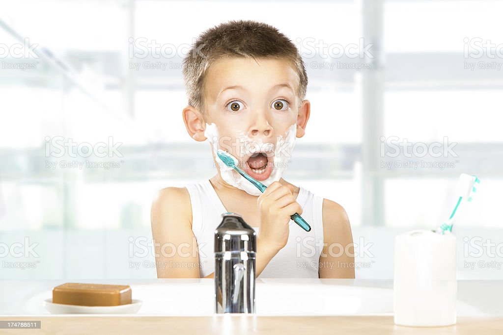 baby shaves with dad stock photo