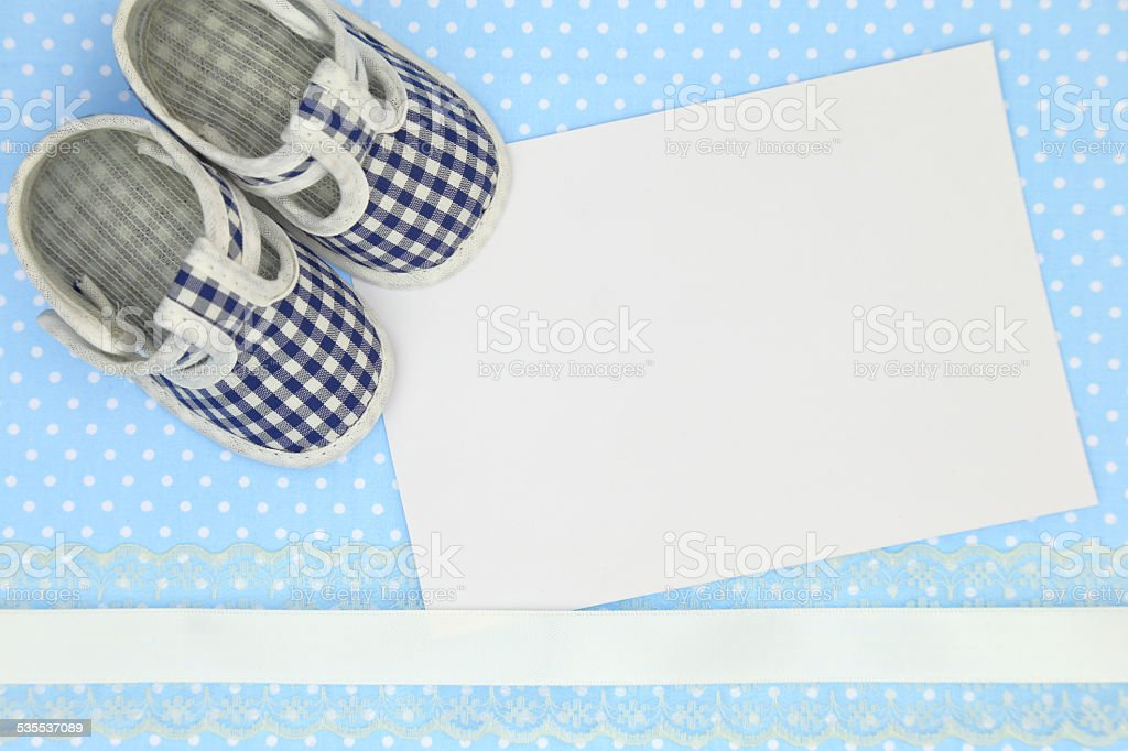 Baby Shoes And Blank Card On Blue Polka Background stock ...