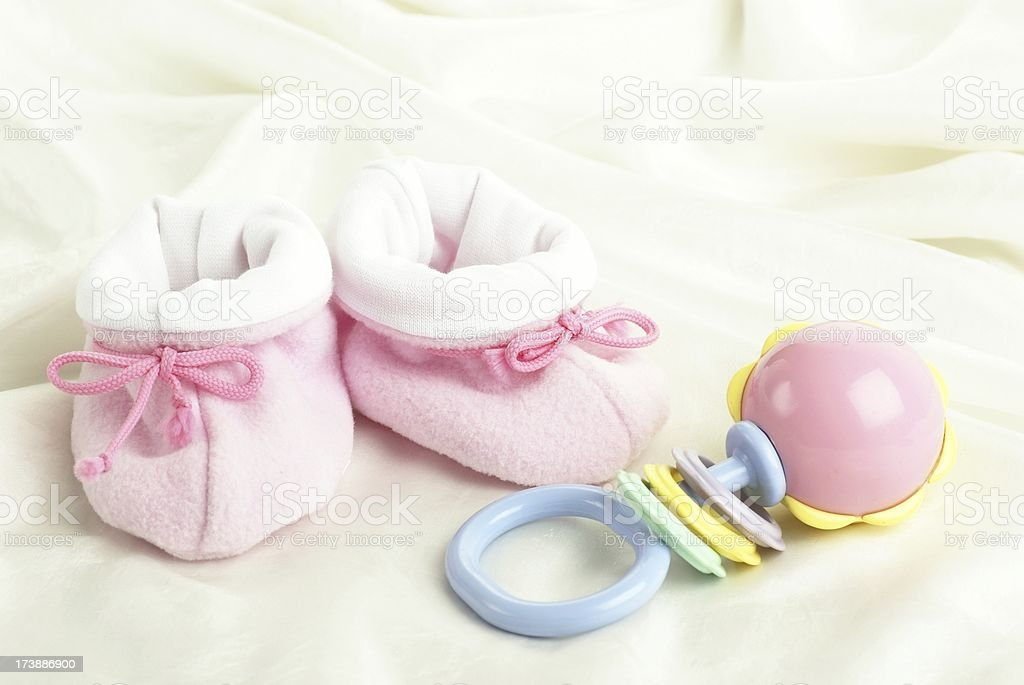 Baby shoes and toy stock photo