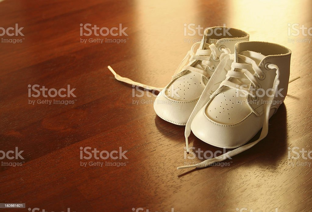 Baby Shoes in Light on Wood royalty-free stock photo