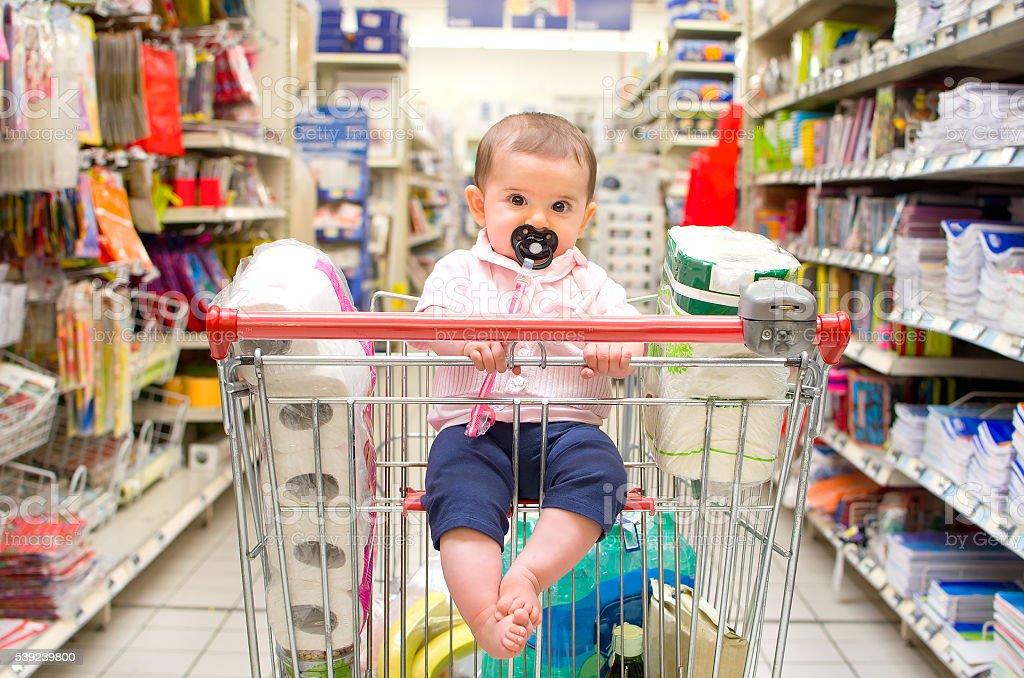 baby shopping cart newborn stock photo