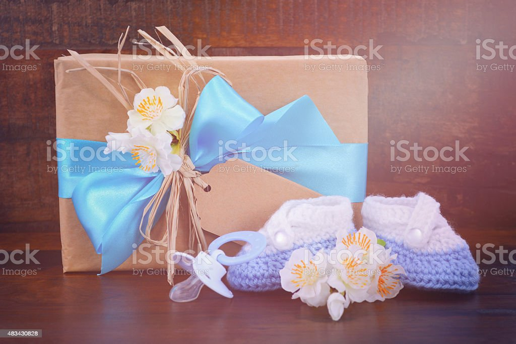 Baby Shower Gift with Booties on Dark Wood stock photo