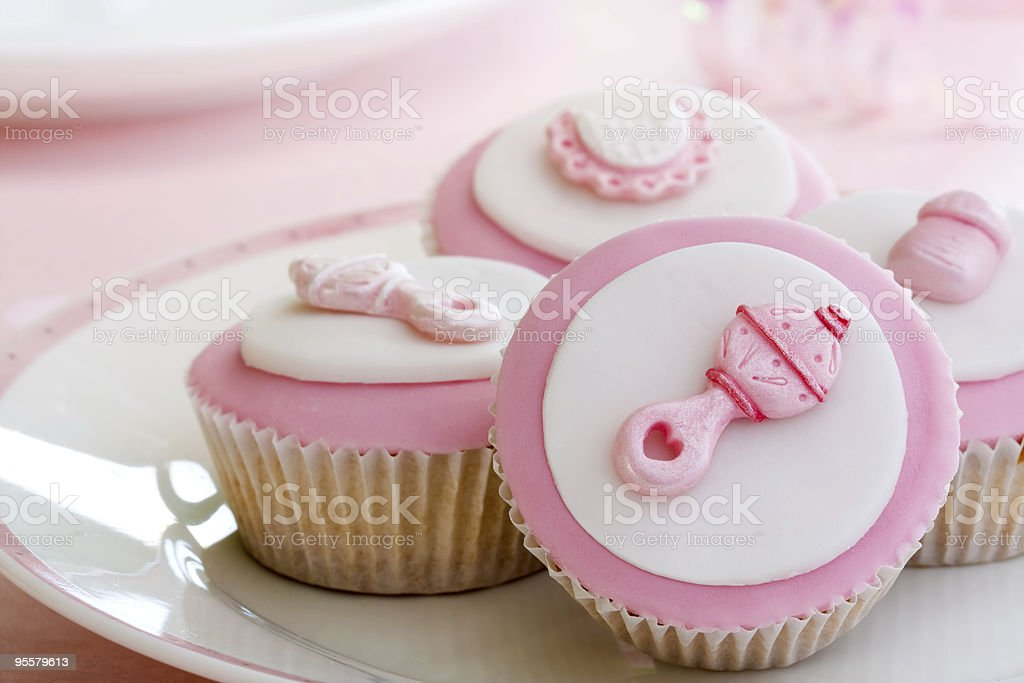 Baby shower themed decorated cupcakes stock photo