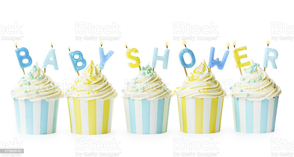 Baby shower themed decorated cupcakes with lit candles stock photo