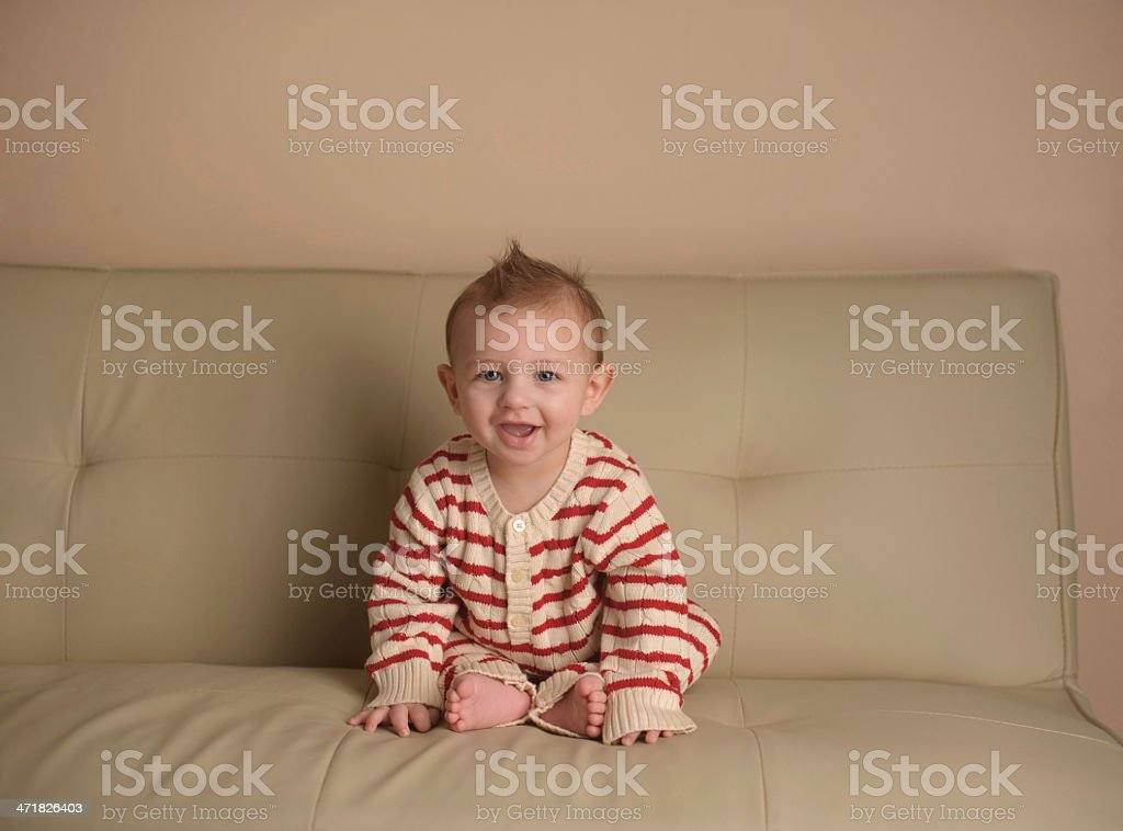 Baby Sitting on Couch Wearing Pajamas royalty-free stock photo