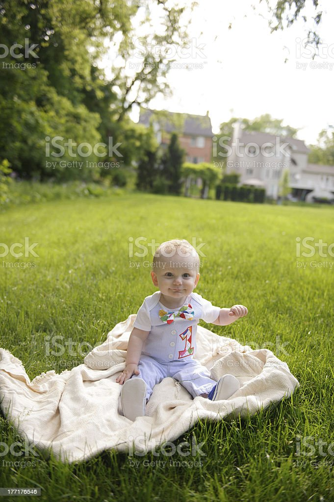 Baby Sitting on Grass Outside During Summer royalty-free stock photo