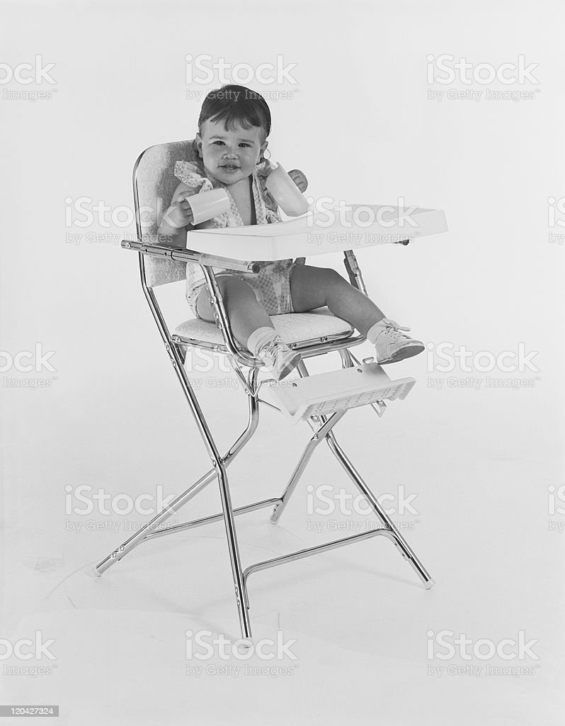 Baby sitting on high chair royalty-free stock photo