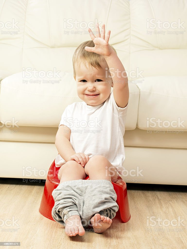 baby sitting on potty in toilet royalty-free stock photo