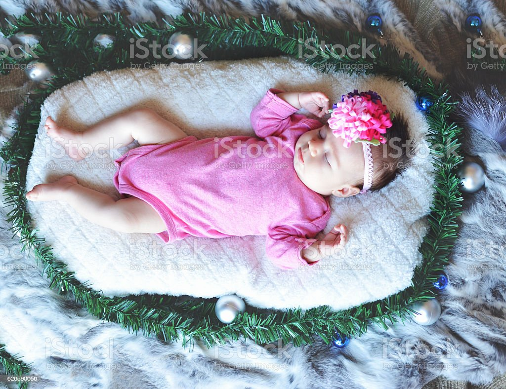 Baby sleep on blanket during New Year stock photo
