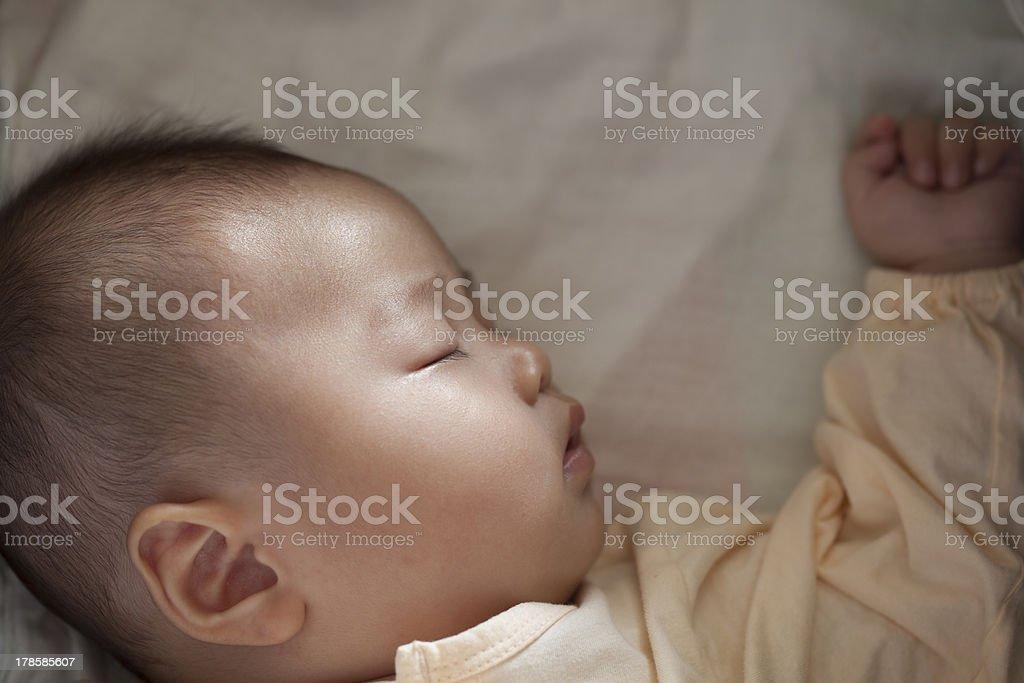 Baby sleep soundly and luminous beam on face stock photo