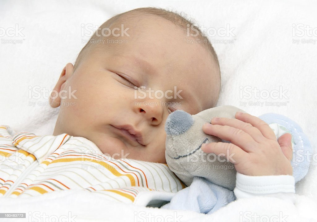 Baby sleeping in bed royalty-free stock photo