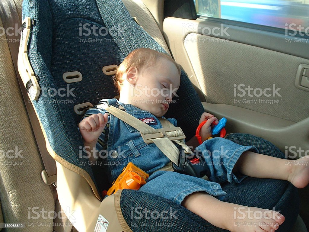 Baby Sleeping in Carseat stock photo