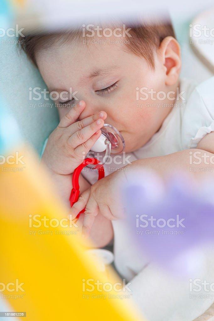 Baby sleeping in crib stock photo