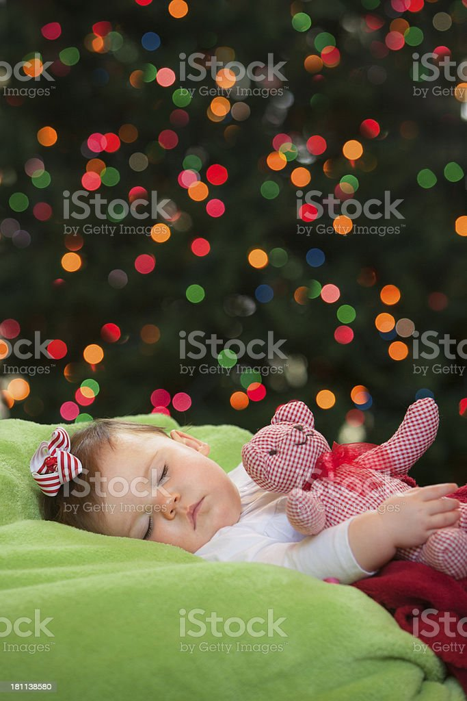Baby Sleeping in Front of Christmas Tree royalty-free stock photo