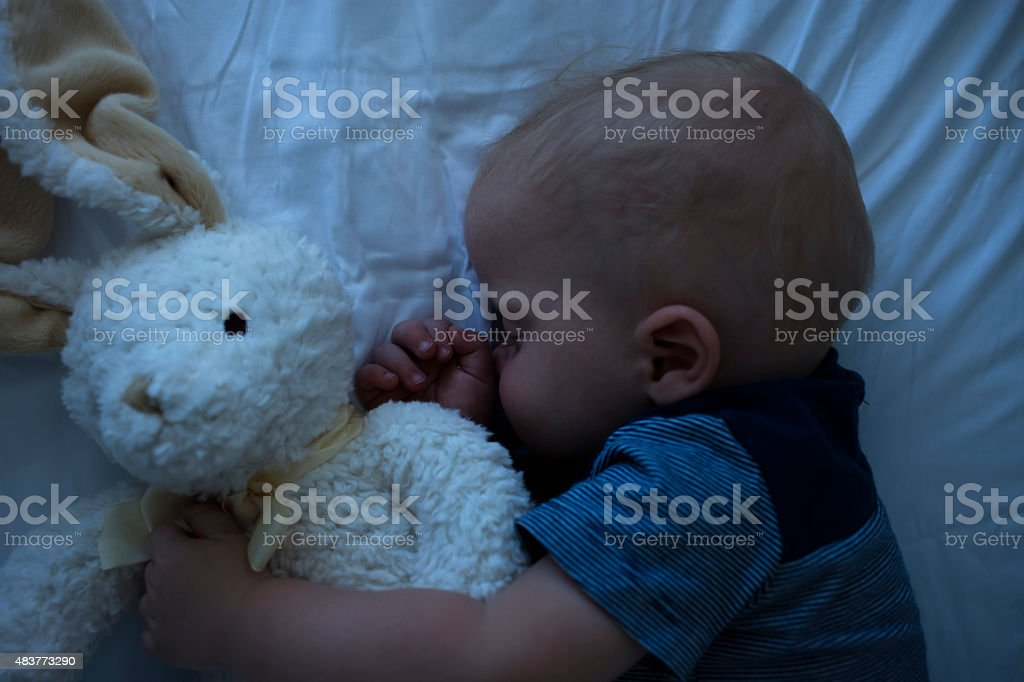 Baby Sleeping in his crib stock photo