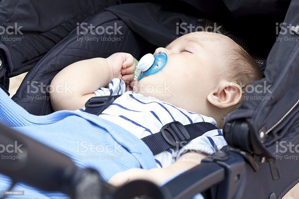 Baby sleeping in perambulator. stock photo