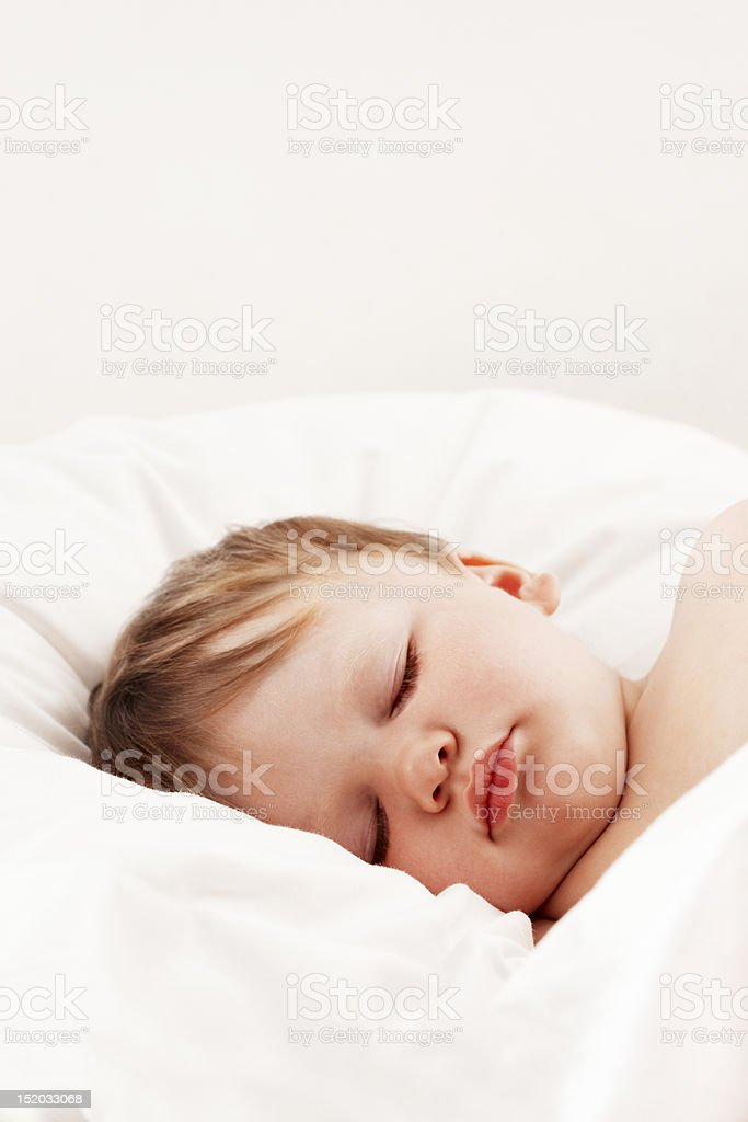 Baby sleeping in white sheets royalty-free stock photo