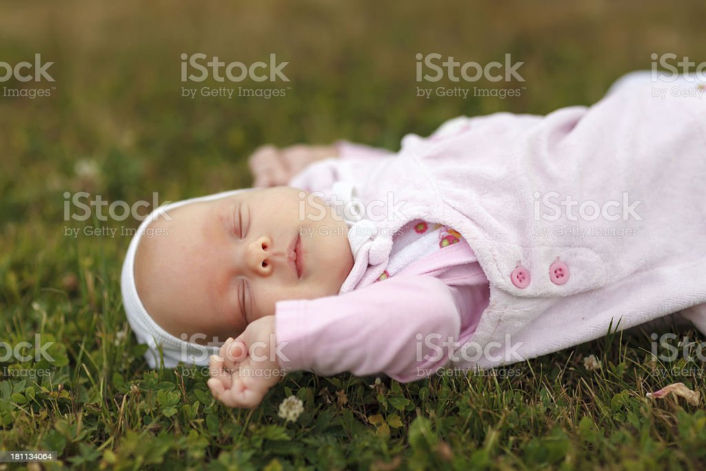 Baby sleeping on green grass royalty-free stock photo